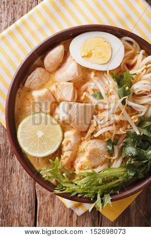 Malaysian Laksa Soup With Chicken Close Up In A Bowl. Vertical Top View