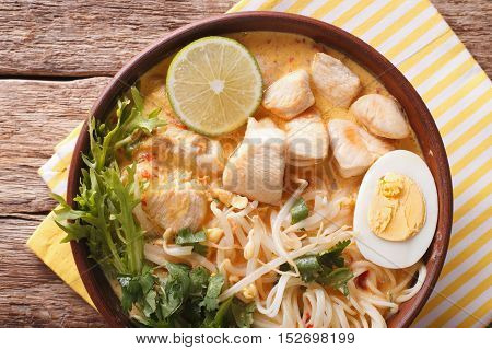 Malaysian Laksa Soup With Chicken Close Up In A Bowl. Horizontal Top View