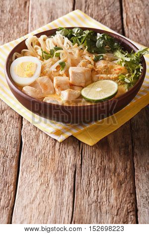 Asian Laksa Soup With Chicken, Egg, Noodles, Sprouts And Coriander. Vertical