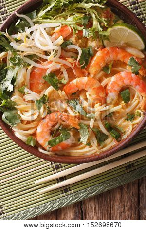 Laksa Soup With Shrimps, Noodles, Sprouts And Coriander In A Bowl Close-up. Vertical Top View