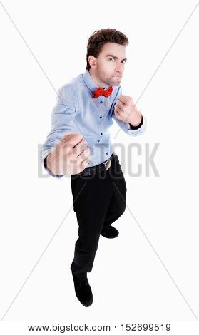 skinny guy funny fights waving his arms and legs. Isolated over white background. Funny guy clumsily boxing. Funny guy with a butterfly on his shirt waving their fists.