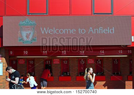 LIVERPOOL UK 17TH SEPTEMBER 2016. Welcome to Anfield sign and people buying tickets at Liverpool Football Club Stadium. Liverpool UK.