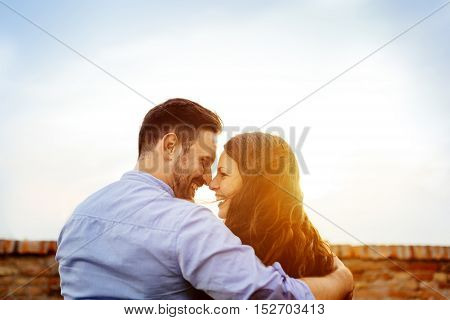 Romantic cute young couple eskimo kissing outdoors