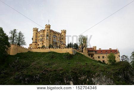 Scenic photograph of castle and the surrounding mountainside. Travel and tourism background.