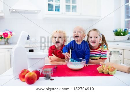 Kids Baking A Pie In White Kitchen