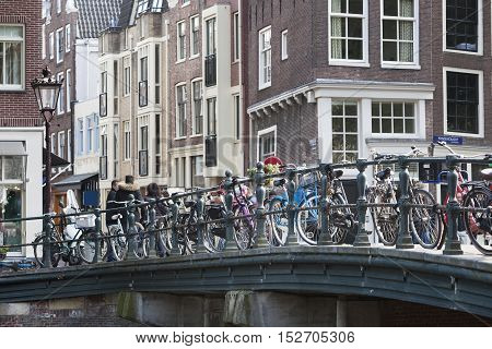 Bicycles attached to a bridge on the Prinsengracht in Amsterdam