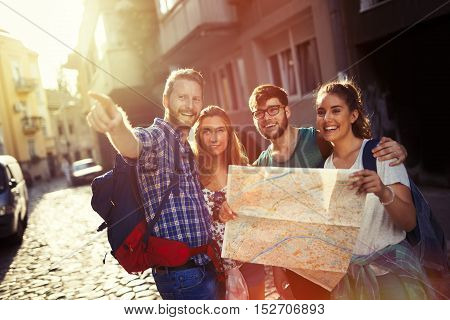 Happy cute tourists exploring travel destination city