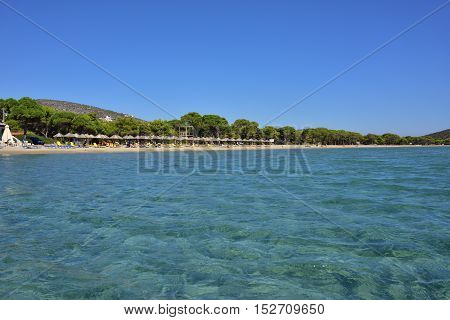 View from water on the beautiful Schinias sandy beach one from most popular beach in Attica Greece