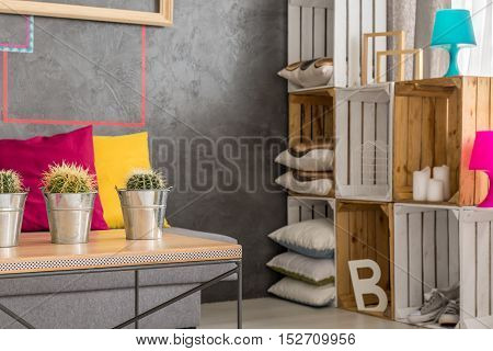 Grey interior with wooden table sofa and diy regale