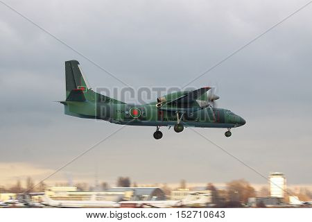 Kiev Ukraine - December 24 2011: Bangladesh Air Force Antonov An-32 cargo plane is landing on sunset