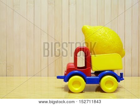 Toy Plastic Car With Yellow Lemon