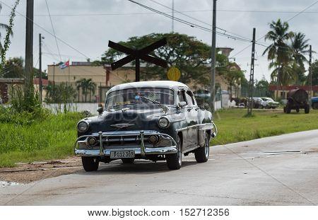 Santa Clara, Cuba - September 05, 2016: American black Chevrolet classic car drive on the street in Santa Clara Cuba - Serie Cuba 2016 Reportage