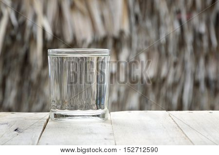 glass of purified water on wooden table