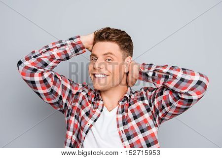 Portrait Of Happy Man Combing His Hair With Fingers
