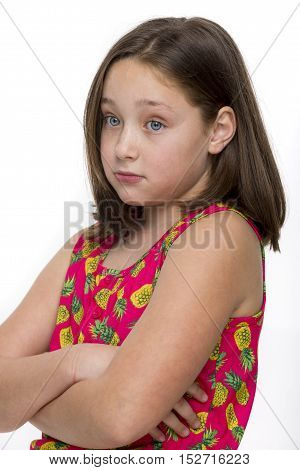 Young girl looking sad and somewhat cynical.