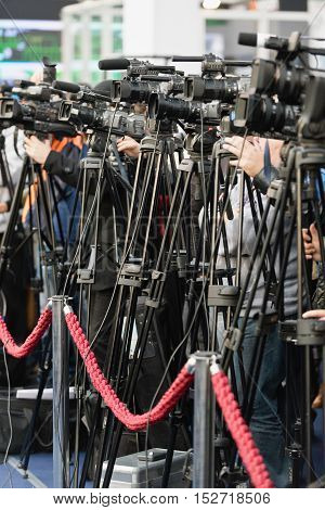 Television camera covering large publicity event, color image