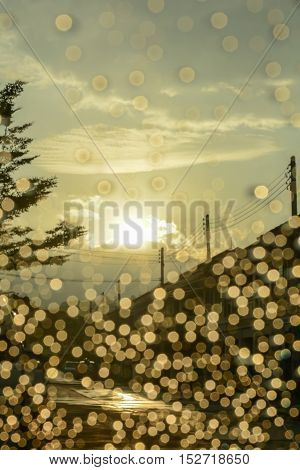 Multitude of raindrops on car windshield at sunset time