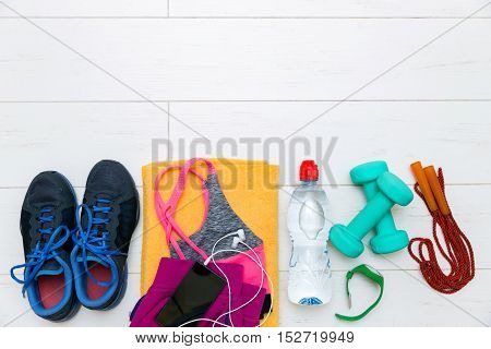 fitness equipment and accessories on white wooden gym floor