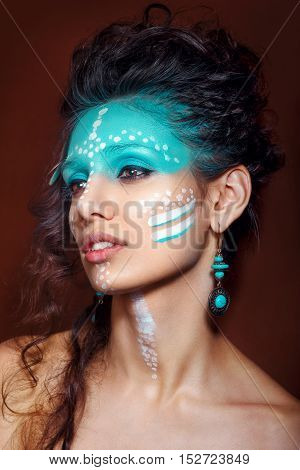 attractive young woman in ethnic jewelry with drum. close up portrait. Beautiful girl shaman. Portrait o