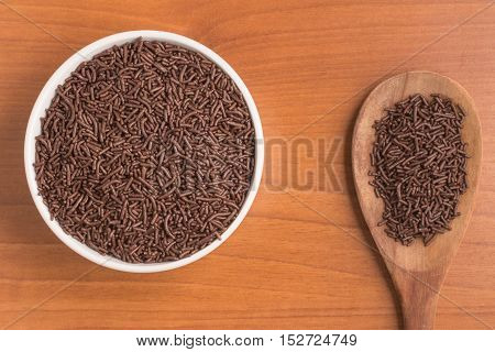 Chocolate Sprinkles Vermicelli over a wooden table