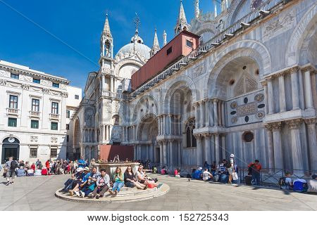 Venice Italy - May 05 2016: Tourists are resting on the Marco Polo square at spring time