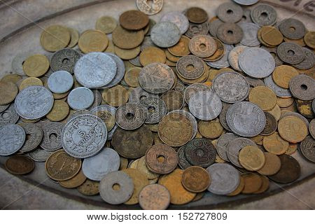 Disused old French coins on a silver plate