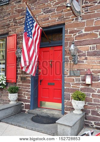 Gettysburg PA - October 14: front door with an American flag. This old historic home was built in 1786.