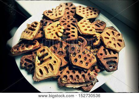 beautiful crust sweet cookies in shape of flowers, cube, rhombus prepare for tea-time