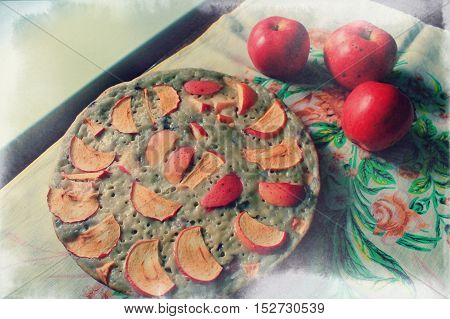 circle form hot and sweet pie from red apples lay on the table prepare to cut