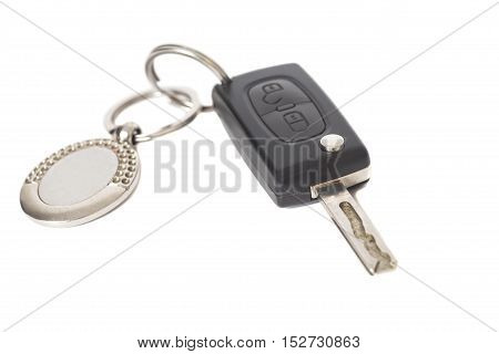 Remote control car key with metal keyring isolated on white background