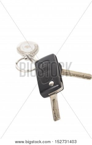 Remote control car keys with metal keyring on isolated white background