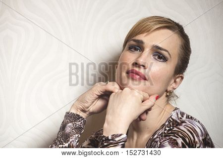 Portrait of Beauty Woman on wallpaper background