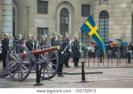 STOCKHOLM, SWEDEN - AUGUST 29, 2016: The standard-bearer with the flag before the formation of the royal guards. Divorce guard at the Royal Palace. Stockholm