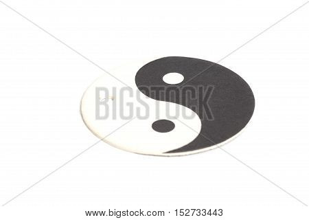 Yin-Yang symbol made of paper isolated on white background