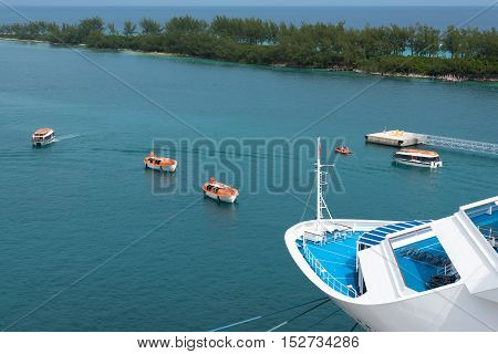 Multiple lifeboats performing a drill from a cruise ship