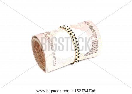 Roll of Indian rupees isolated on white