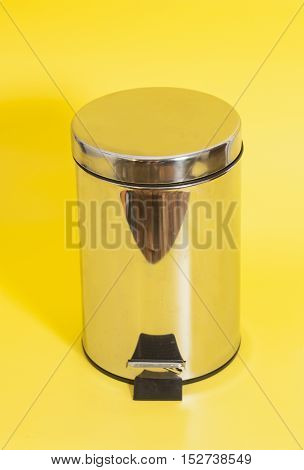 Garbage bin isolated on a yellow background