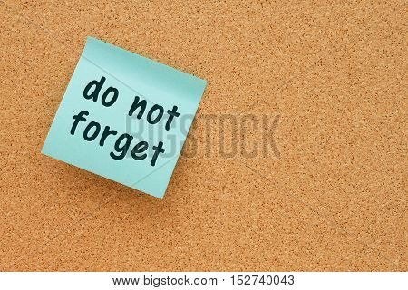 Reminder to do not forget message Bulletin board with a teal sticky note with text do not forget