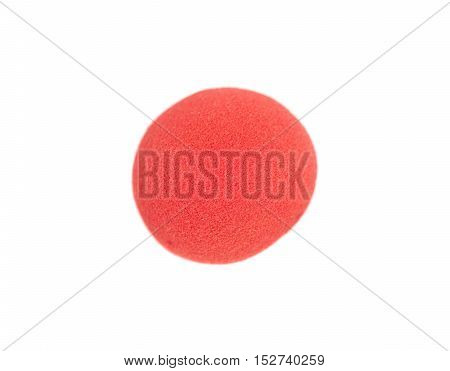 red clown nose isolated on a white