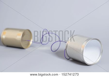 tin can phone on a gray . communication concept