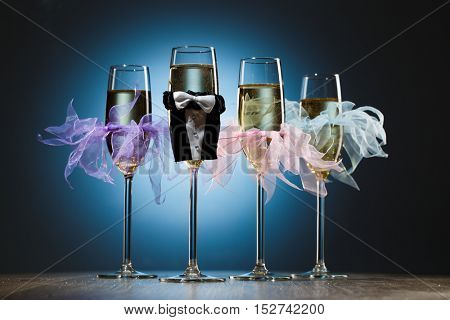 Conceptual decorated champagne glasses for party