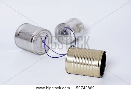 Tin can phone on gray .Tele communication concept