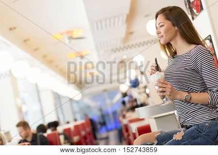 Woman Eating In Diner