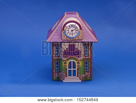 Model of house on blue background .