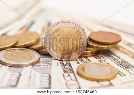 Euro coins over dollar US notes money