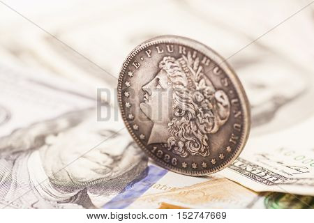 US dollar bills money and  silver coin