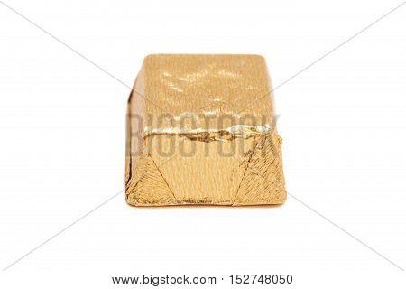 Gold chocolate bonbon isolated on white background