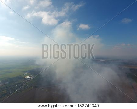 The Smoke Over The Village. Clubs Of Smoke Over The Village Houses And Fields. Aerophotographing Are