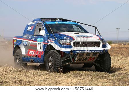 Forty Five Degree Close-up View Of Speeding  White And Blue Ford Ranger Rally Car