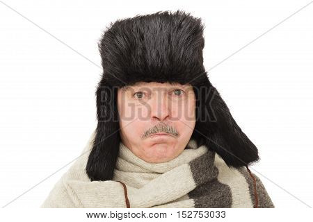 Pensioner in russian traditional hat. elderly man in warm fur hat with earflaps.